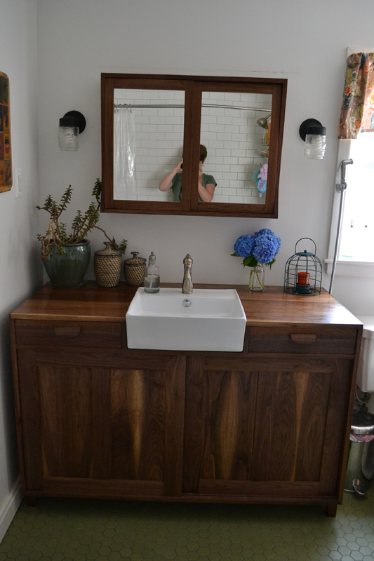 custom walnut vanity and medicine cabinet sliding doors