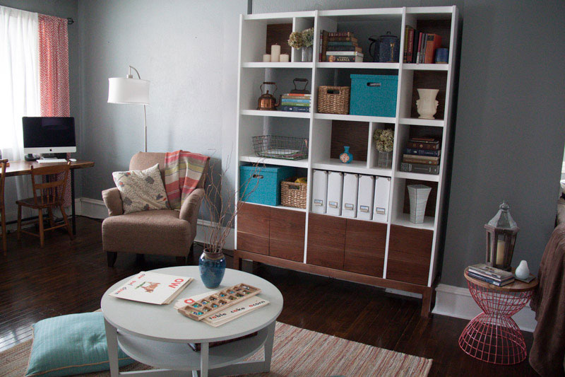 Living room decorated by brass tacks home with custom walnut bookcase