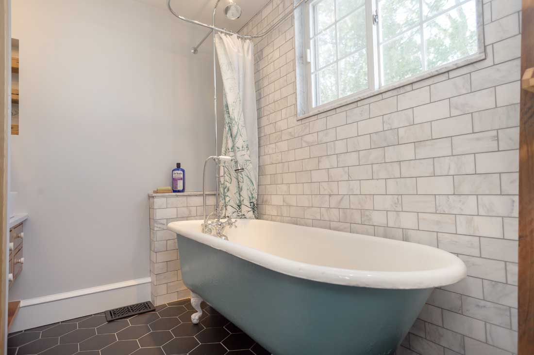 Marble-tile-subway-wall-cast-iron-clawfoot-tub-shower